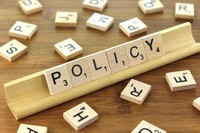 Scrabble pieces spelling out Policy
